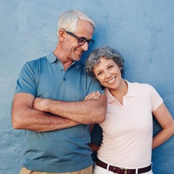 Older couple standing in front of blue wall