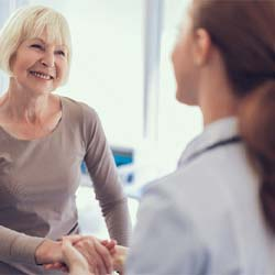 Man in collared shirt smiling in dental chair