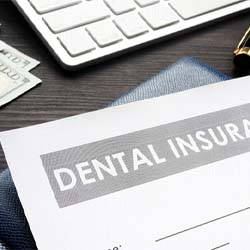 Female friends standing together and smiling outside