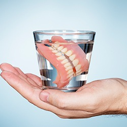 Full dentures in glass of water